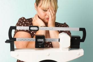 fat-woman-on-scales-sad-2682769-2